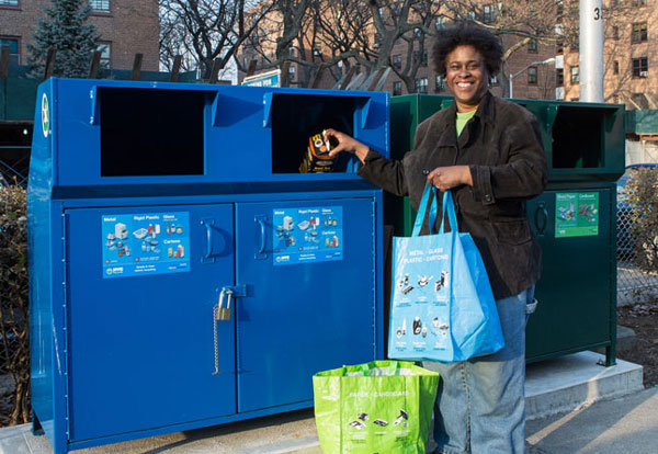 woman in front of recycling